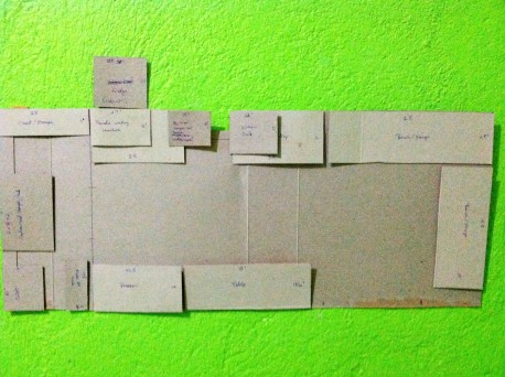 cereal box cardboard floor plan taped to wall so i can move pieces around